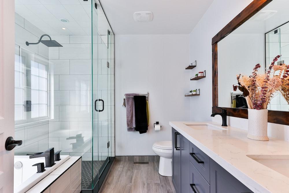 white ceramic sink near white ceramic sink