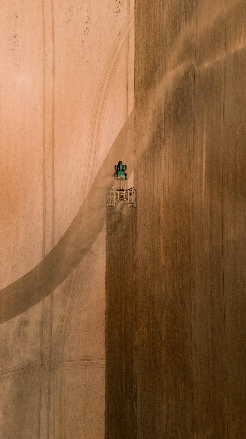 people walking on brown wooden floor