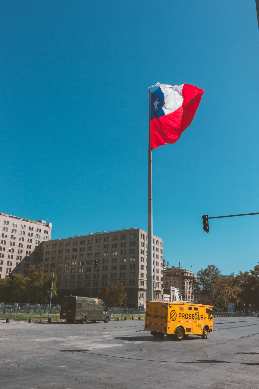 white red and blue flag on pole during daytime