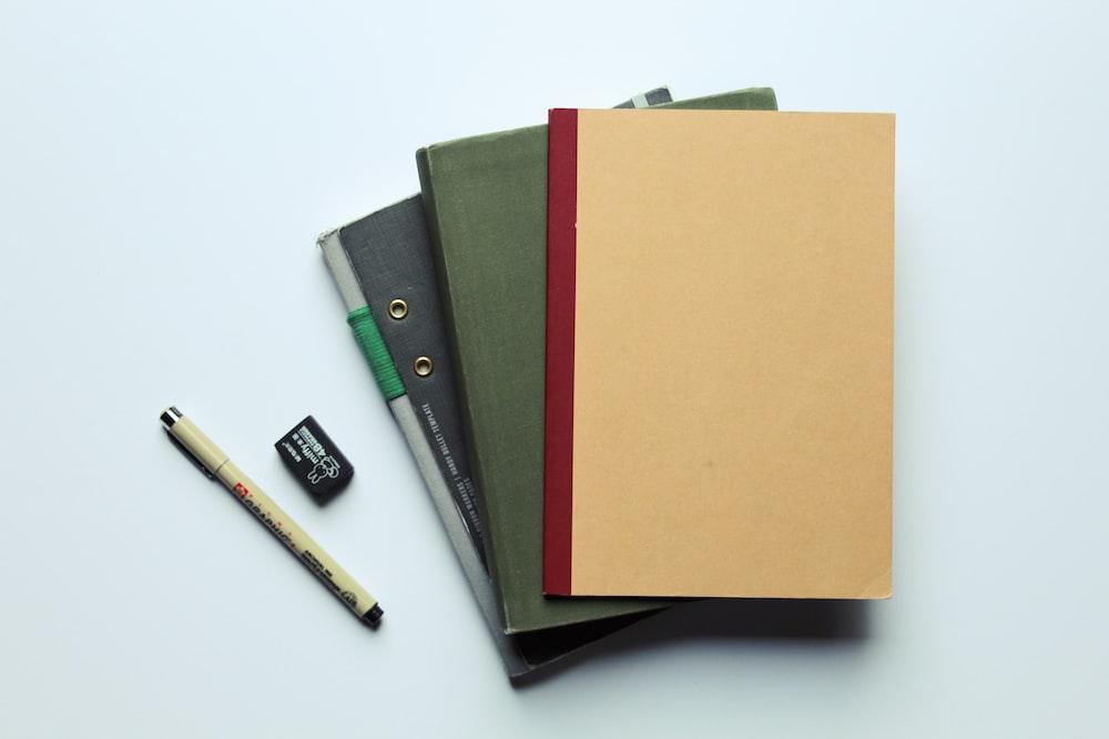 orange folder on black leather wallet