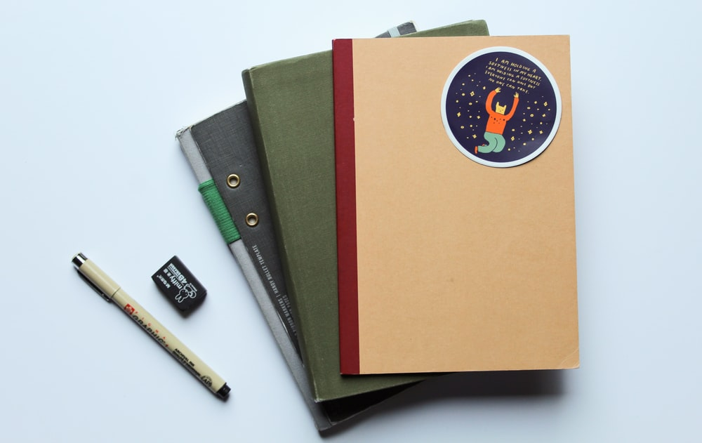 orange folder with black and white pen