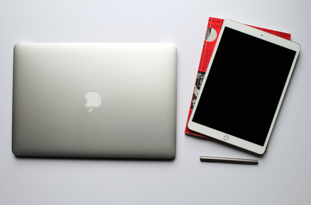 silver macbook beside silver iphone 6