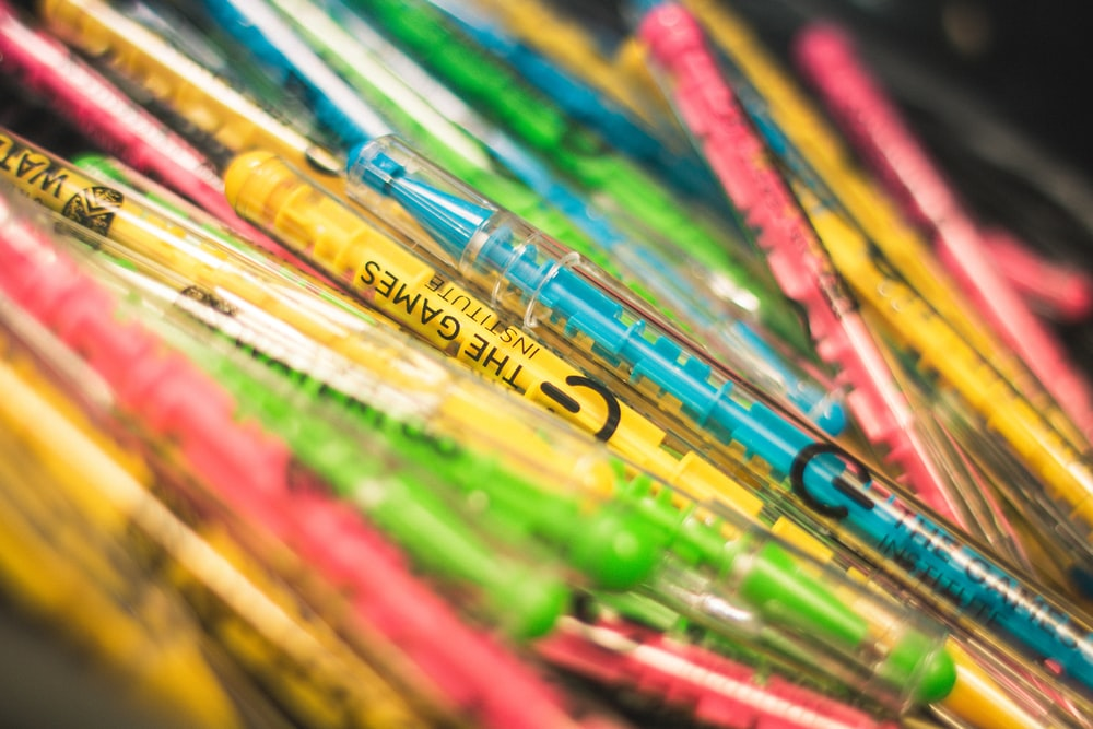 multi colored pen lot in close up photography