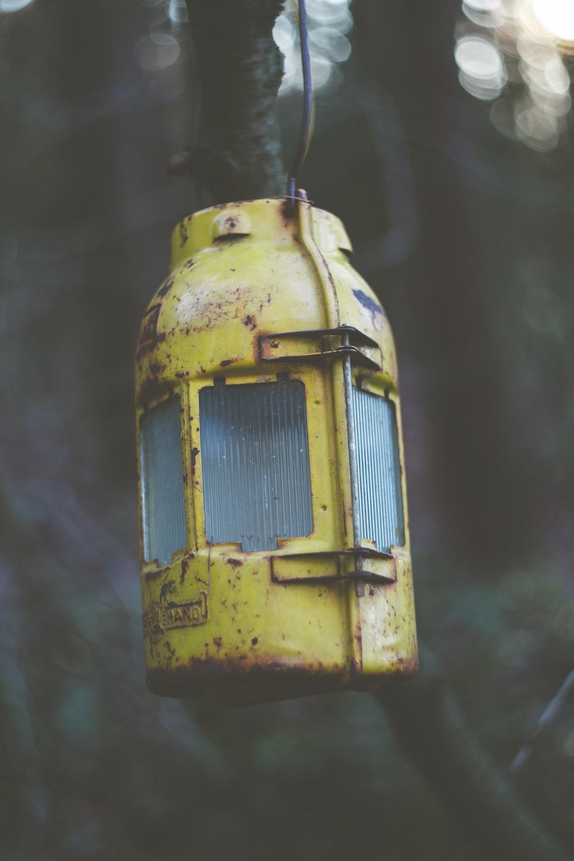 yellow and black lantern lamp