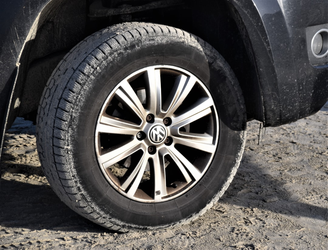 Volkswagen Wheel in sand of Beach