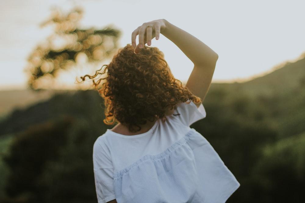 girl in white sleeveless dress