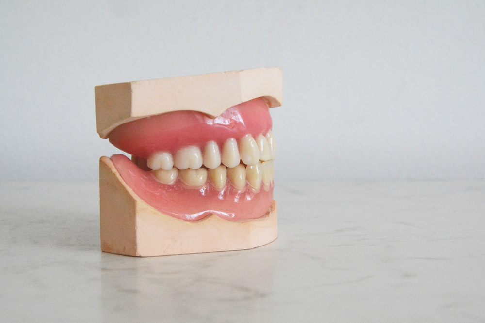 brown cardboard box with white and red round medication pills