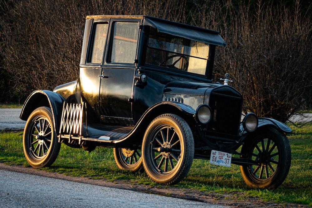 black vintage car on green grass field during daytime
