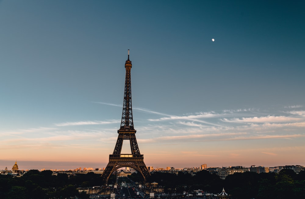eiffel tower under blue sky during sunset