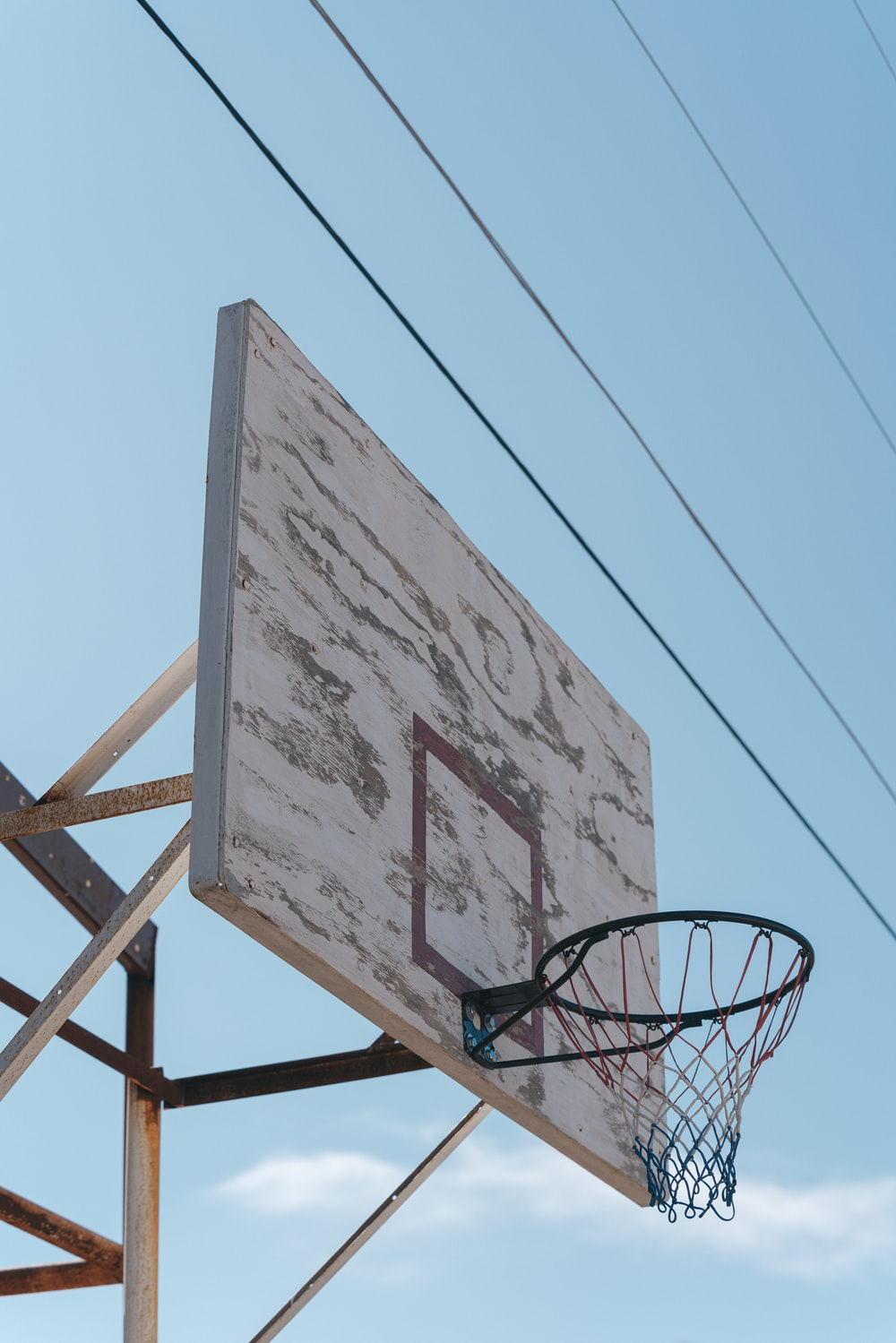 basketball hoop under blue sky during daytime