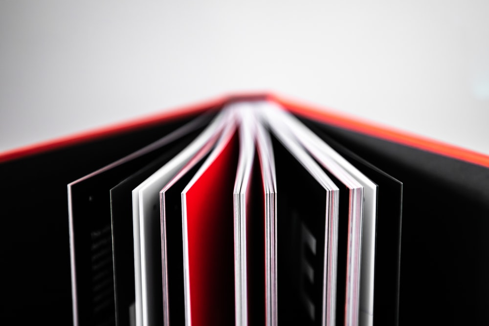 black red and white striped textile