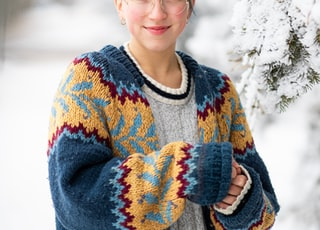 woman in blue and white sweater smiling