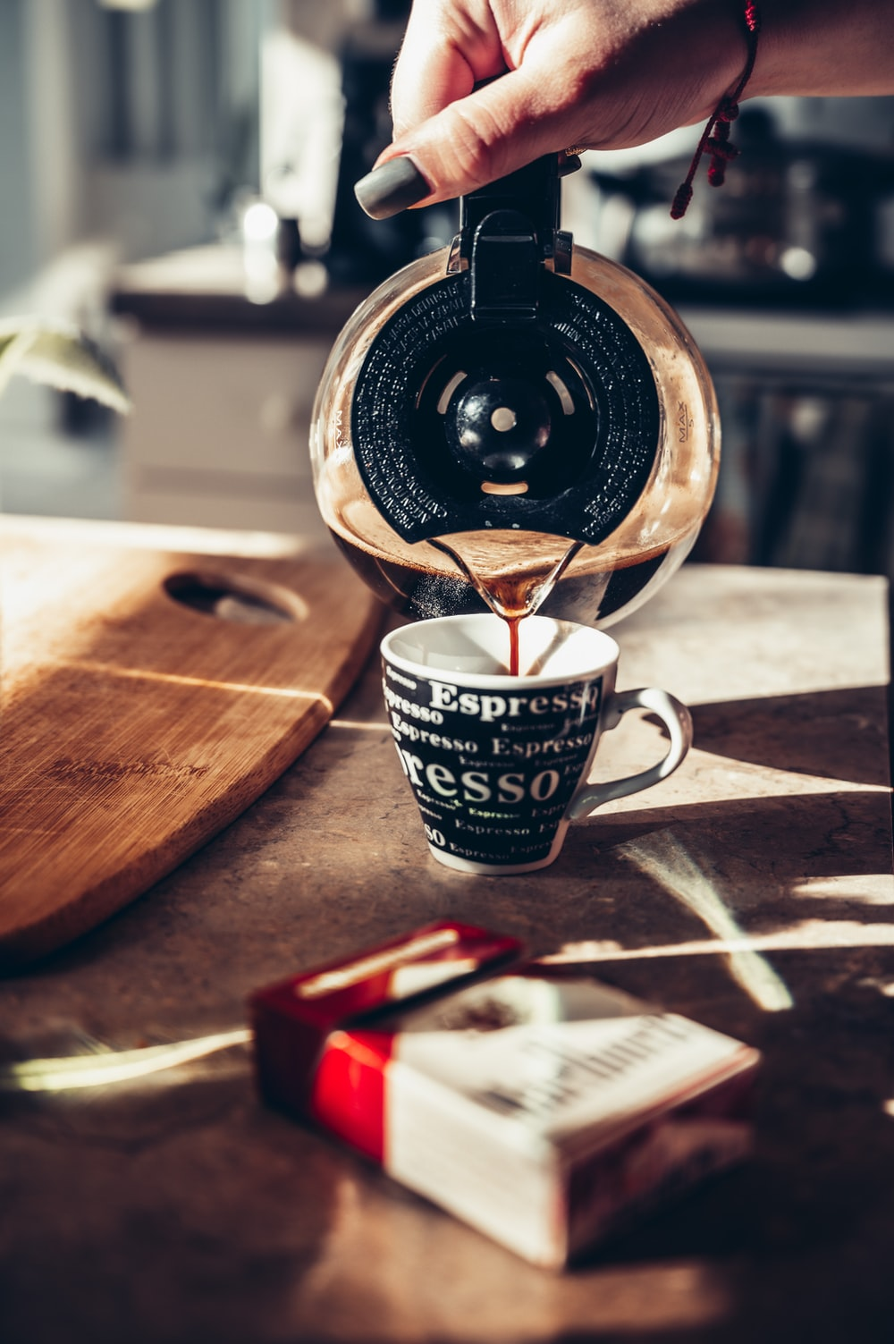 white and black ceramic mug on brown wooden table