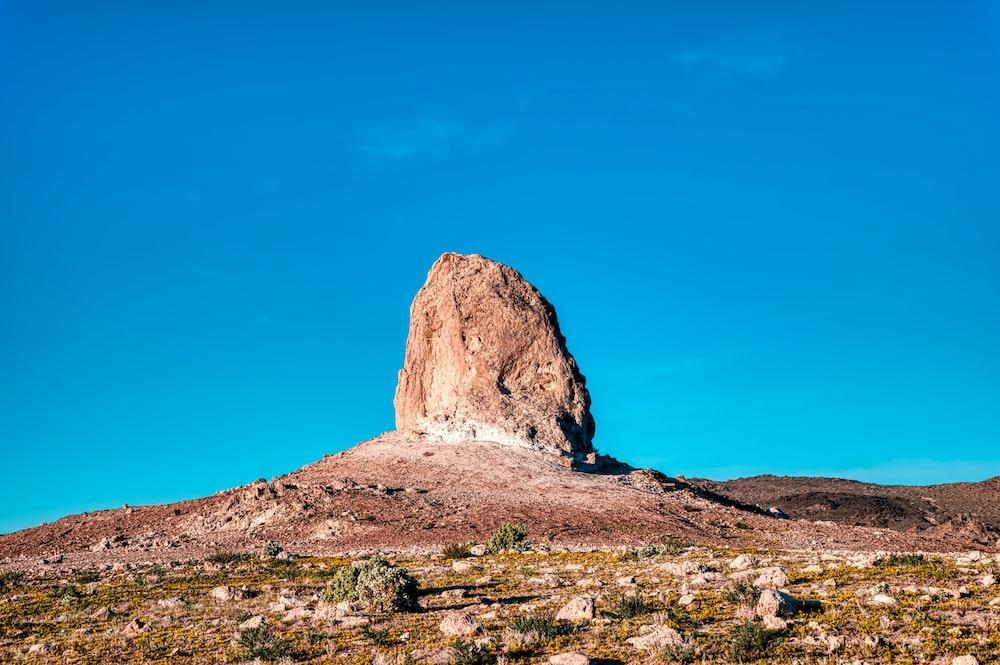 brown rock formation under blue sky during daytime