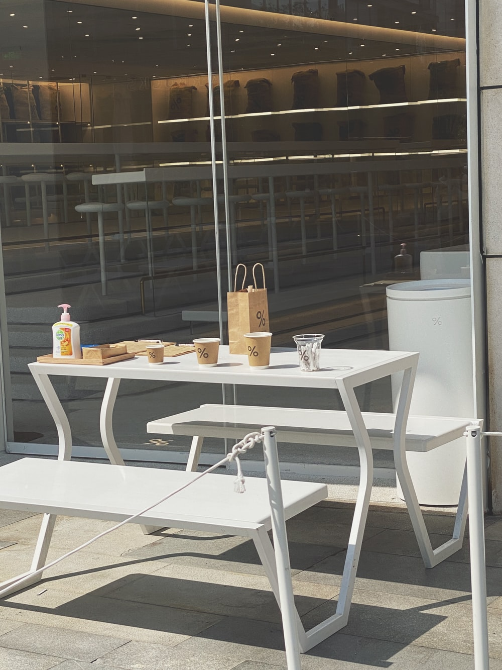 white wooden table with chairs