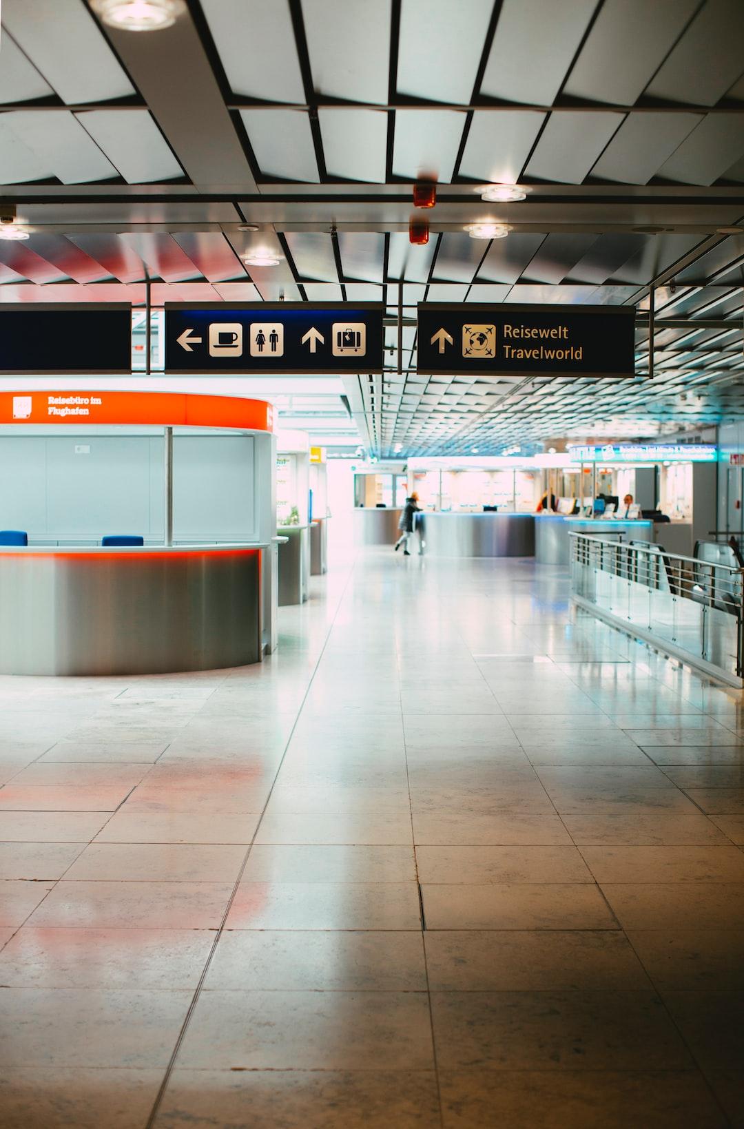 Deserted Airport - curfew gate dusk-to-dawn curfew. Coronavirus disease outbreak (COVID-19) – warning alarm.