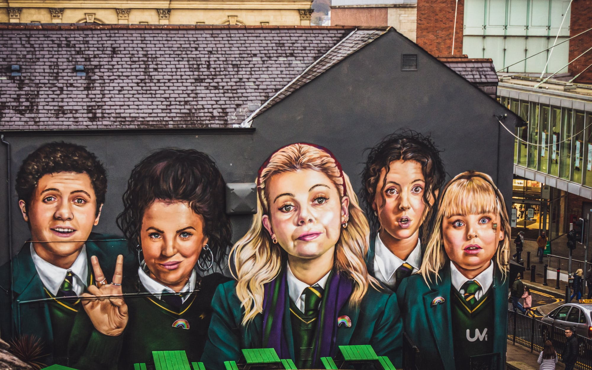 Mural of the Derry Girls from the popular TV comedy of the same name in the city centre shopping district near the Derry City Walls.