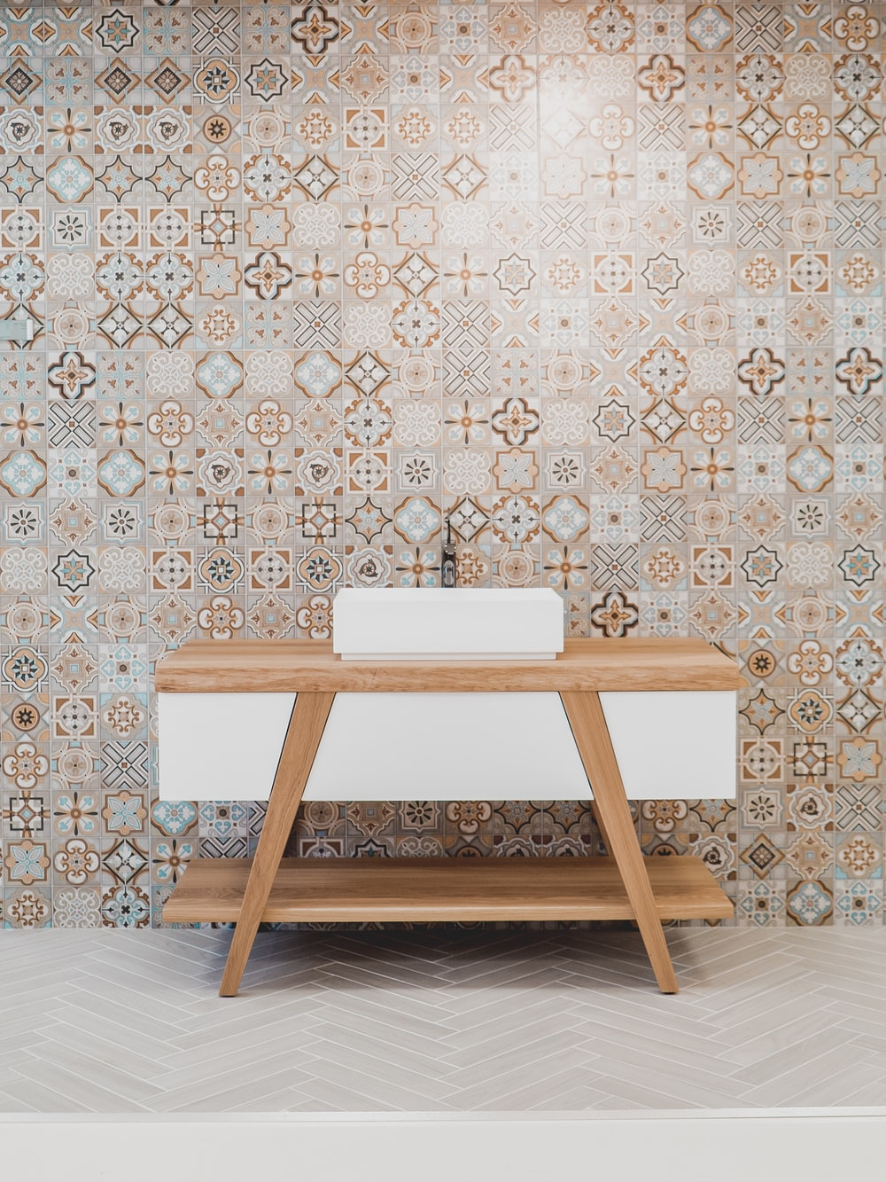 brown wooden table beside white and black wall