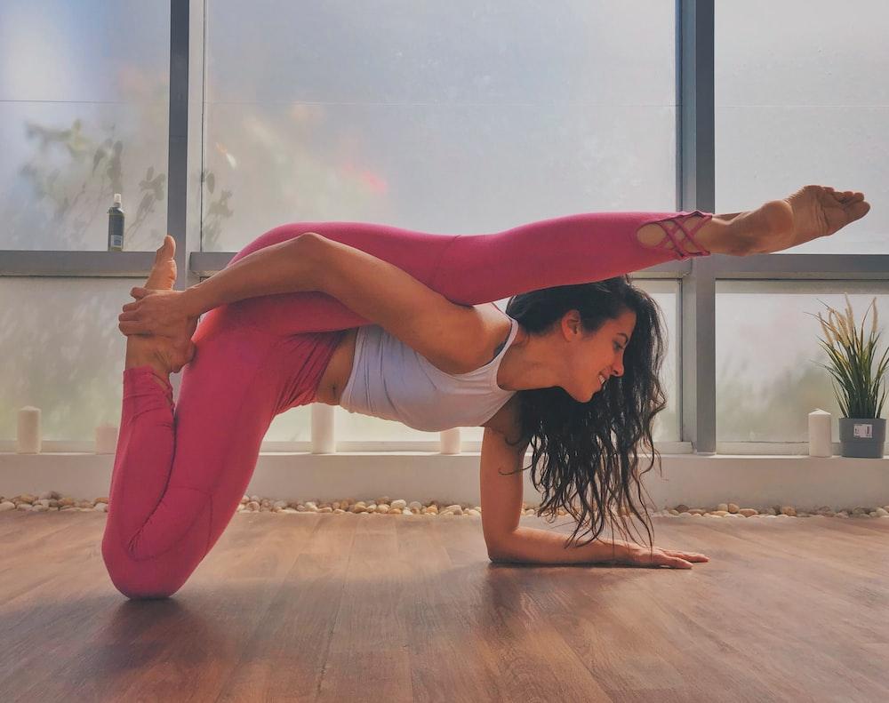woman in pink leggings bending her body