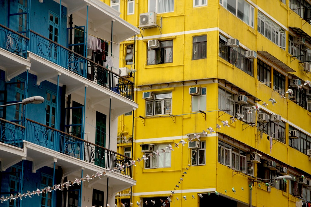 yellow concrete building during daytime