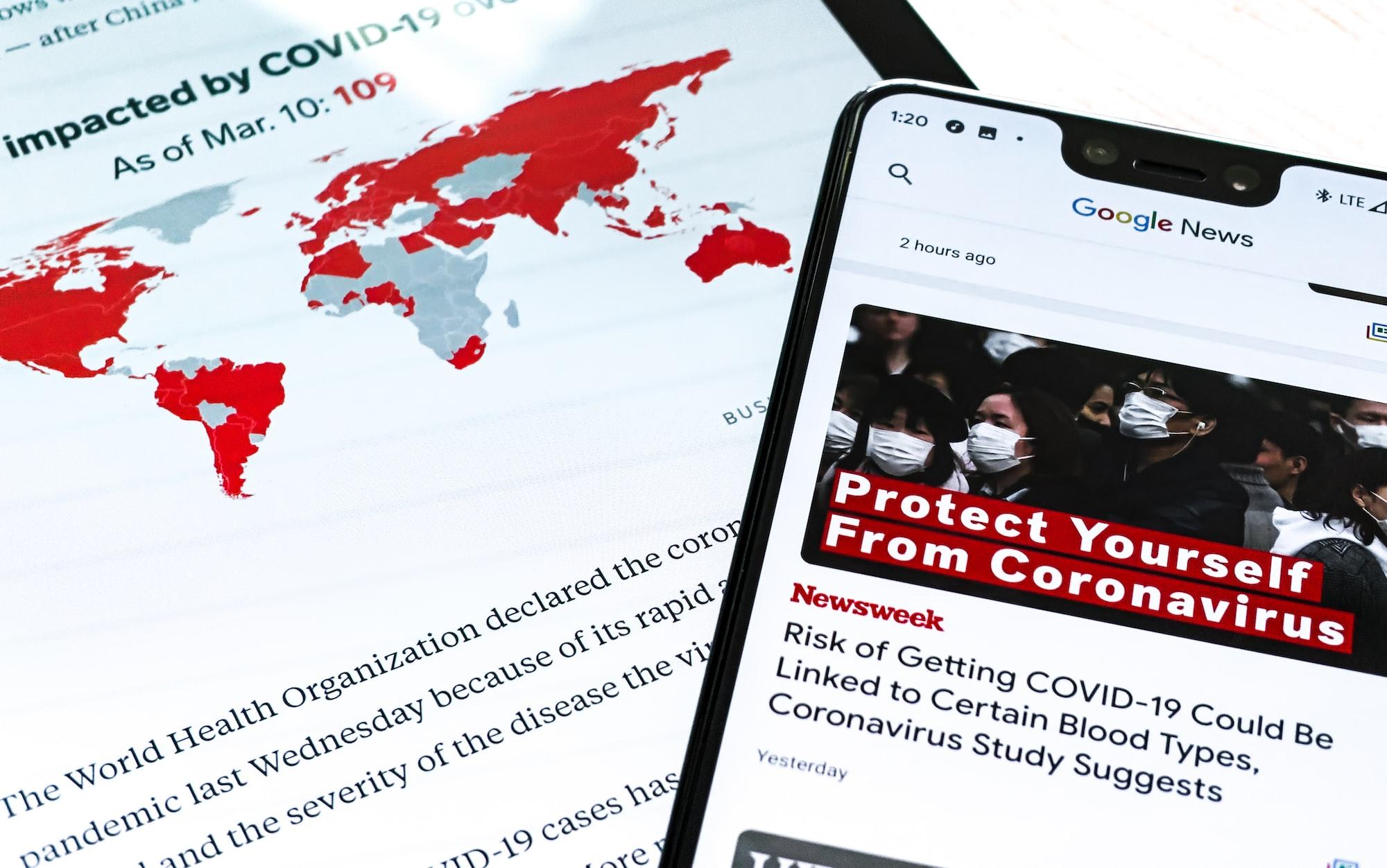 A Samsung Galaxy Tab S and Google Pixel 3XL show Coronavirus information.