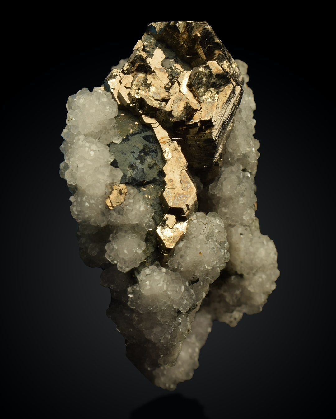 Pyrrhotite is an iron sulfide mineral related to iron pyrite, which is one of the minerals known as Fool's Gold. Pyrrhotite, although not one of the Fool's Gold minerals, is sometimes called magnetic pyrite as it is weakly magnetic. It is most valued as a collectors mineral.