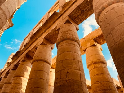 brown concrete pillars under blue sky during daytime egypt zoom background
