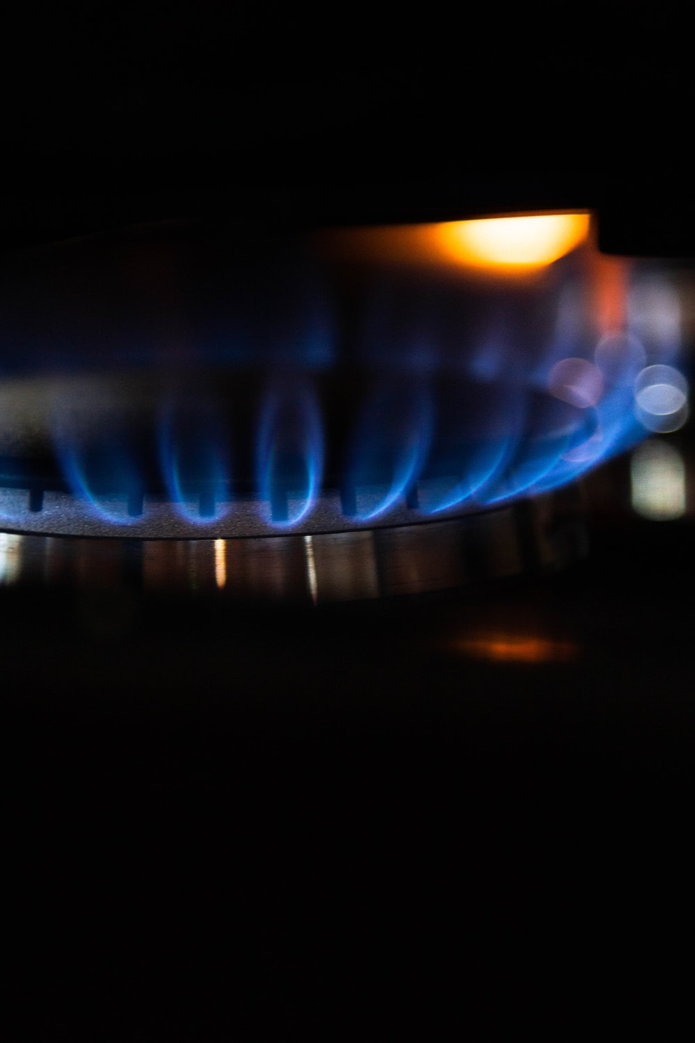 blue and red flame in close up photography