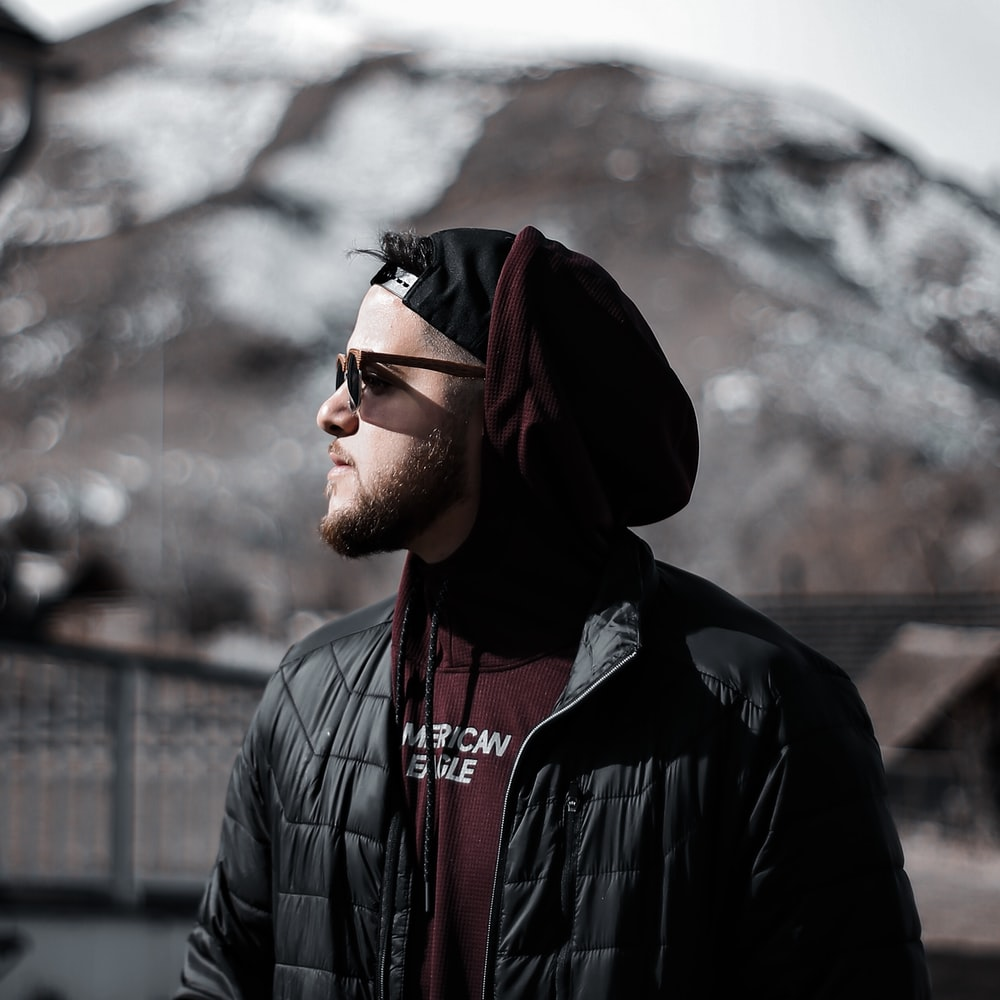 man in black leather jacket wearing black framed eyeglasses