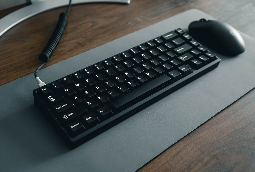 black computer keyboard on gray table