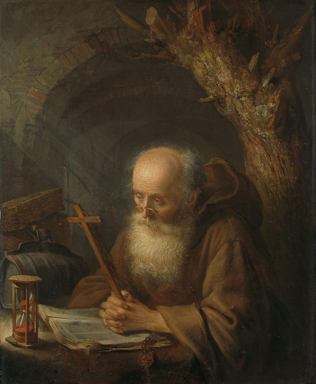 man in brown robe painting