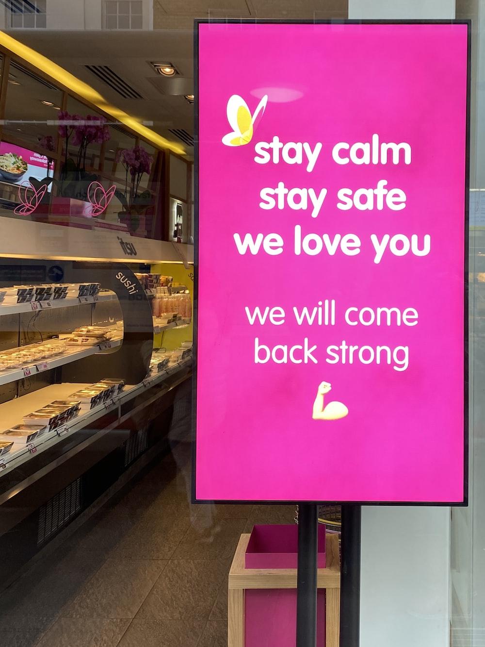 purple and pink kanji text signage
