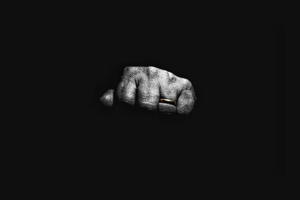 gray scale photo of human hand