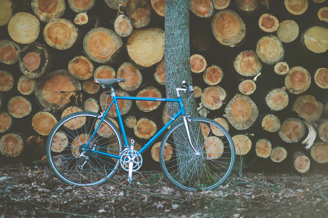 Vintage customized urban retro racing bike in front of a stack of wood