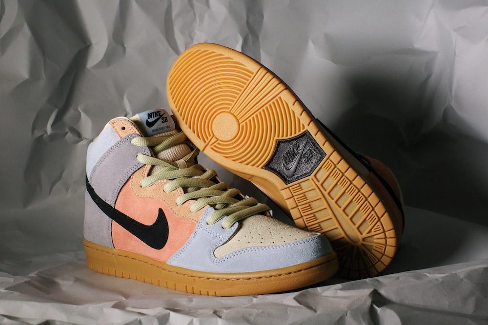 white and orange nike athletic shoes