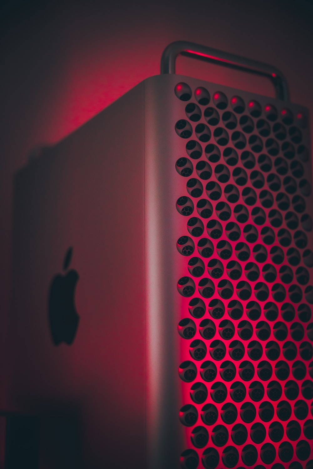 silver ipad on red textile