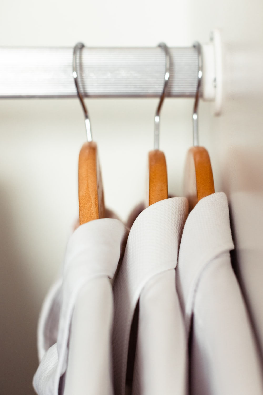 white and brown clothes hanger
