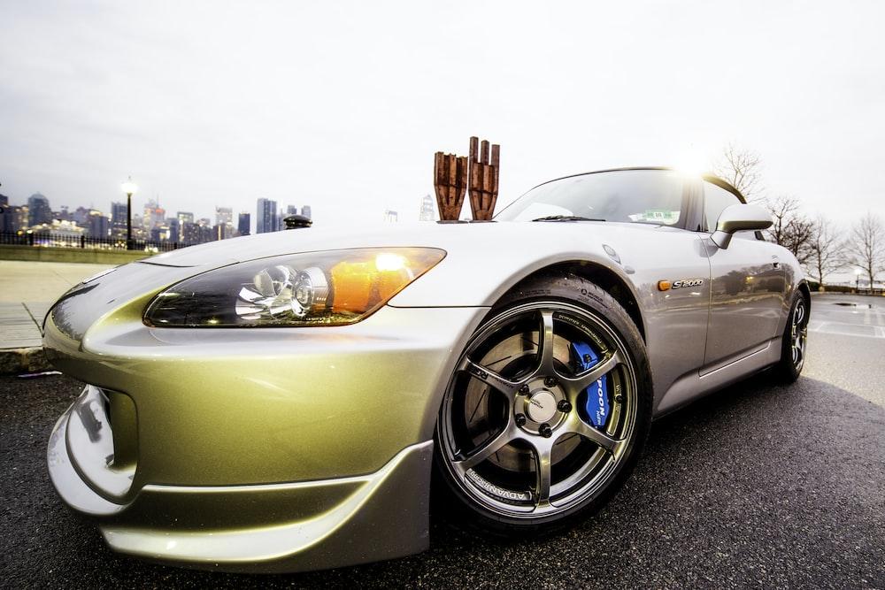 silver porsche 911 parked on parking lot during daytime