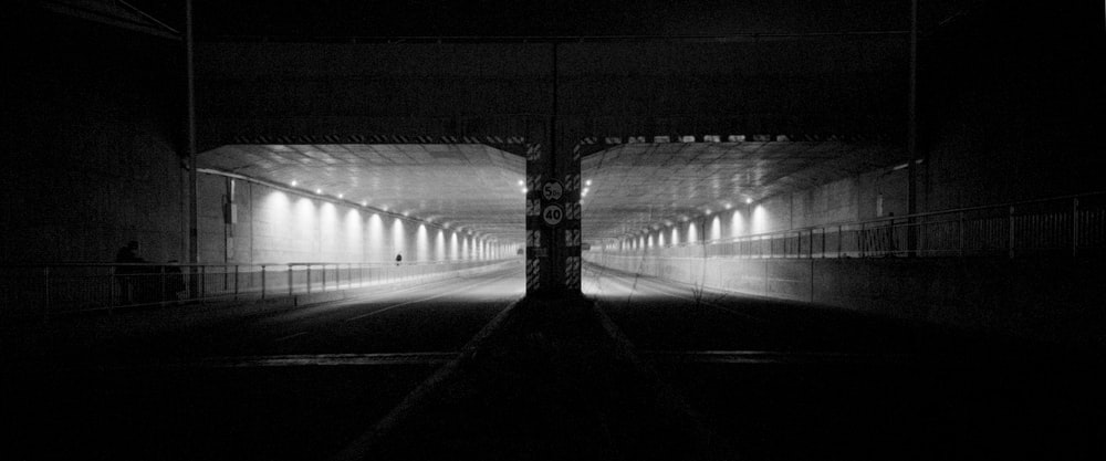 grayscale photo of lighted hallway