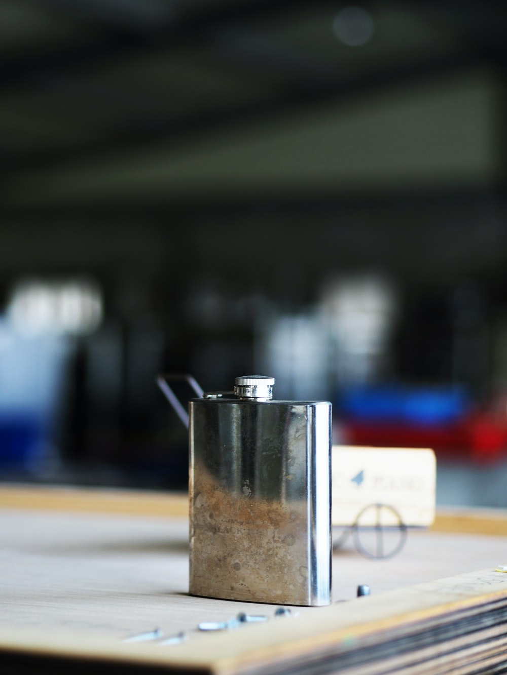 silver and black steel container on white table