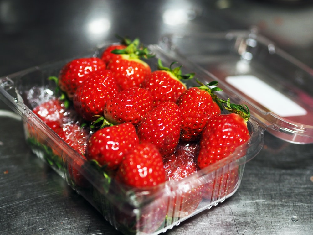 strawberries in clear plastic container