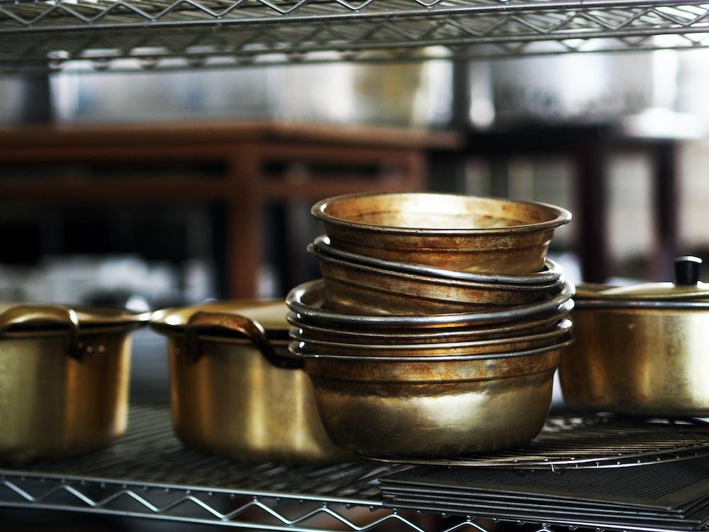 brown ceramic mug on stainless steel tray