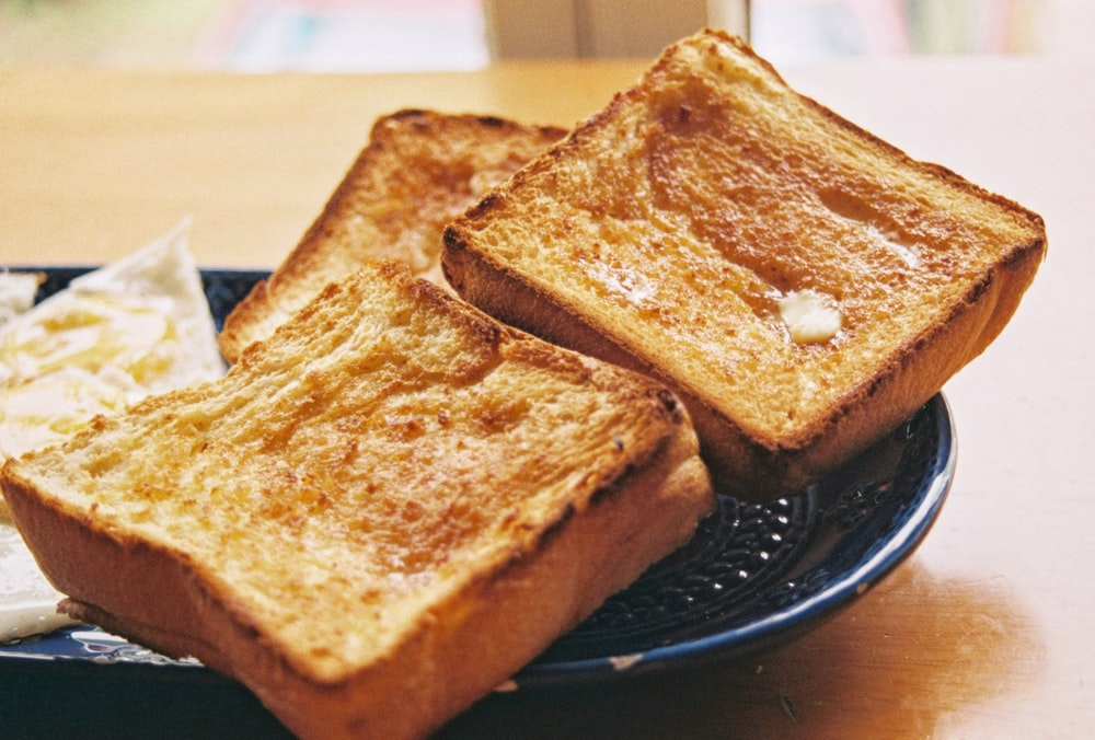toasted bread on black round plate