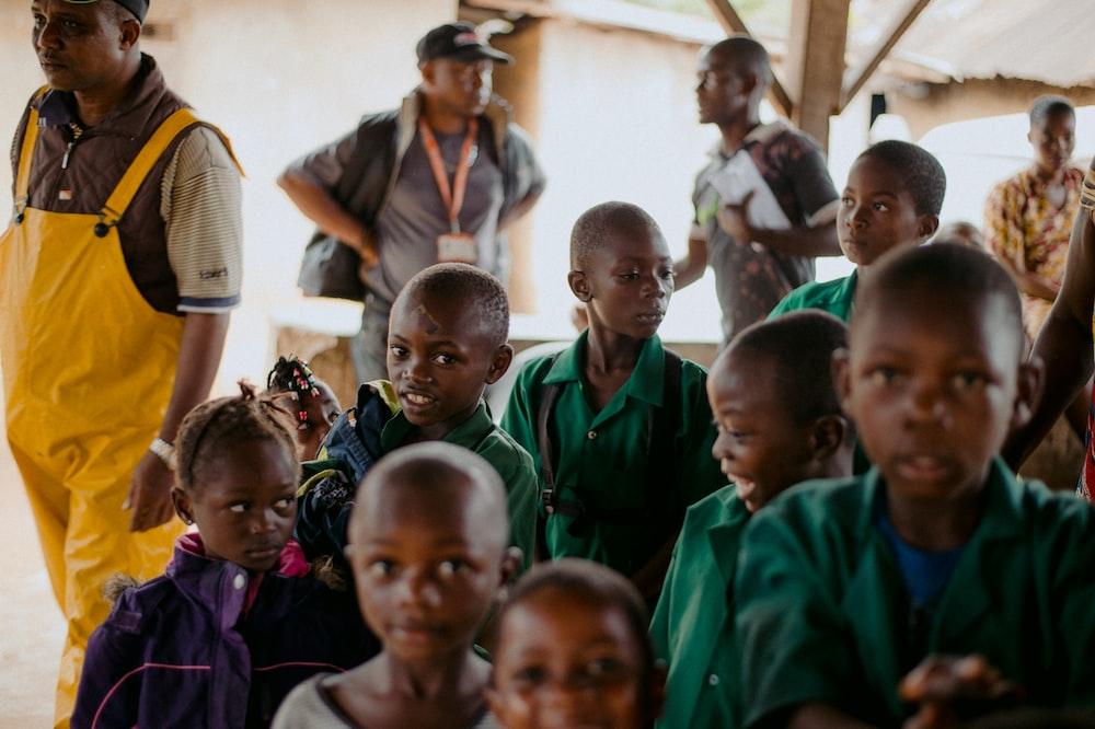 children in green school uniform