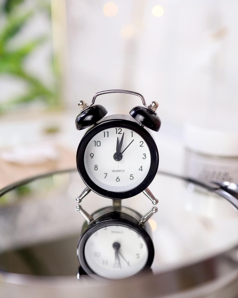 silver and white alarm clock