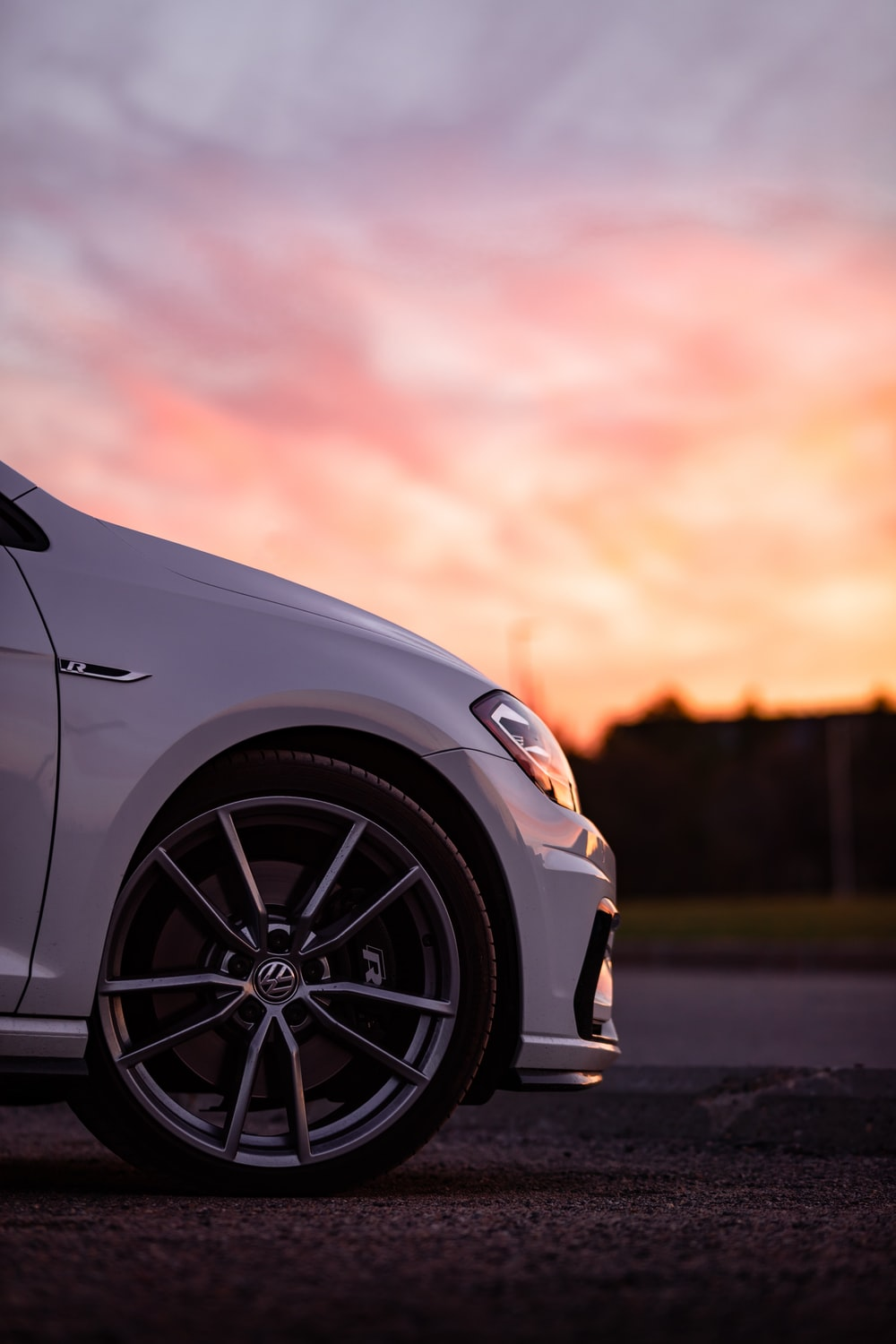 white car on road during sunset