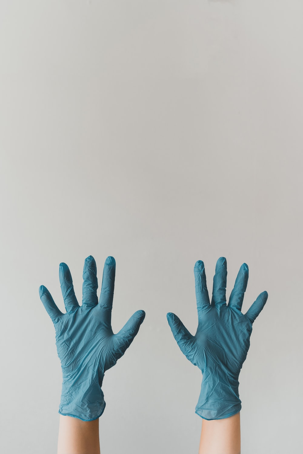 persons left hand with white background