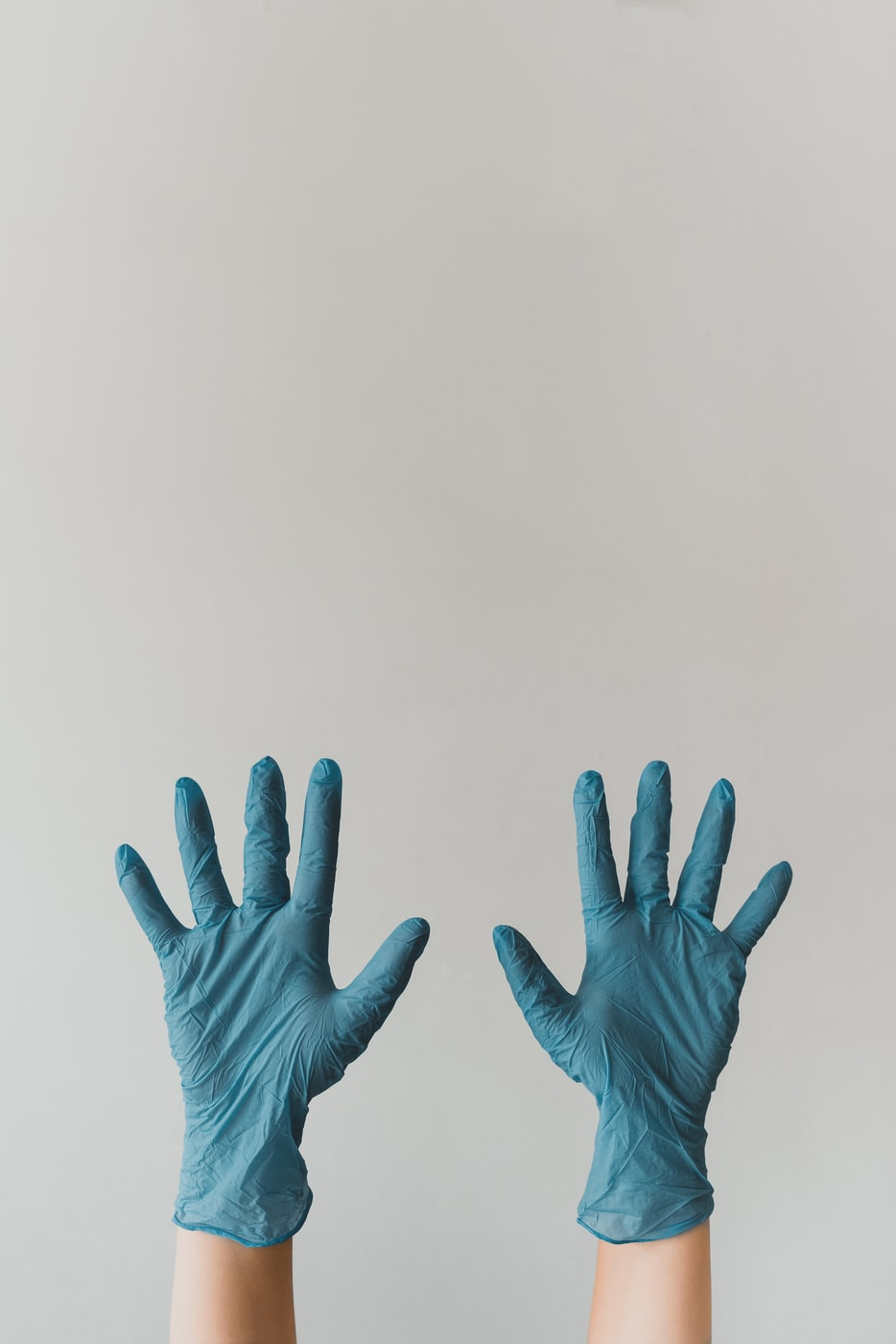 A pair of gloved hands