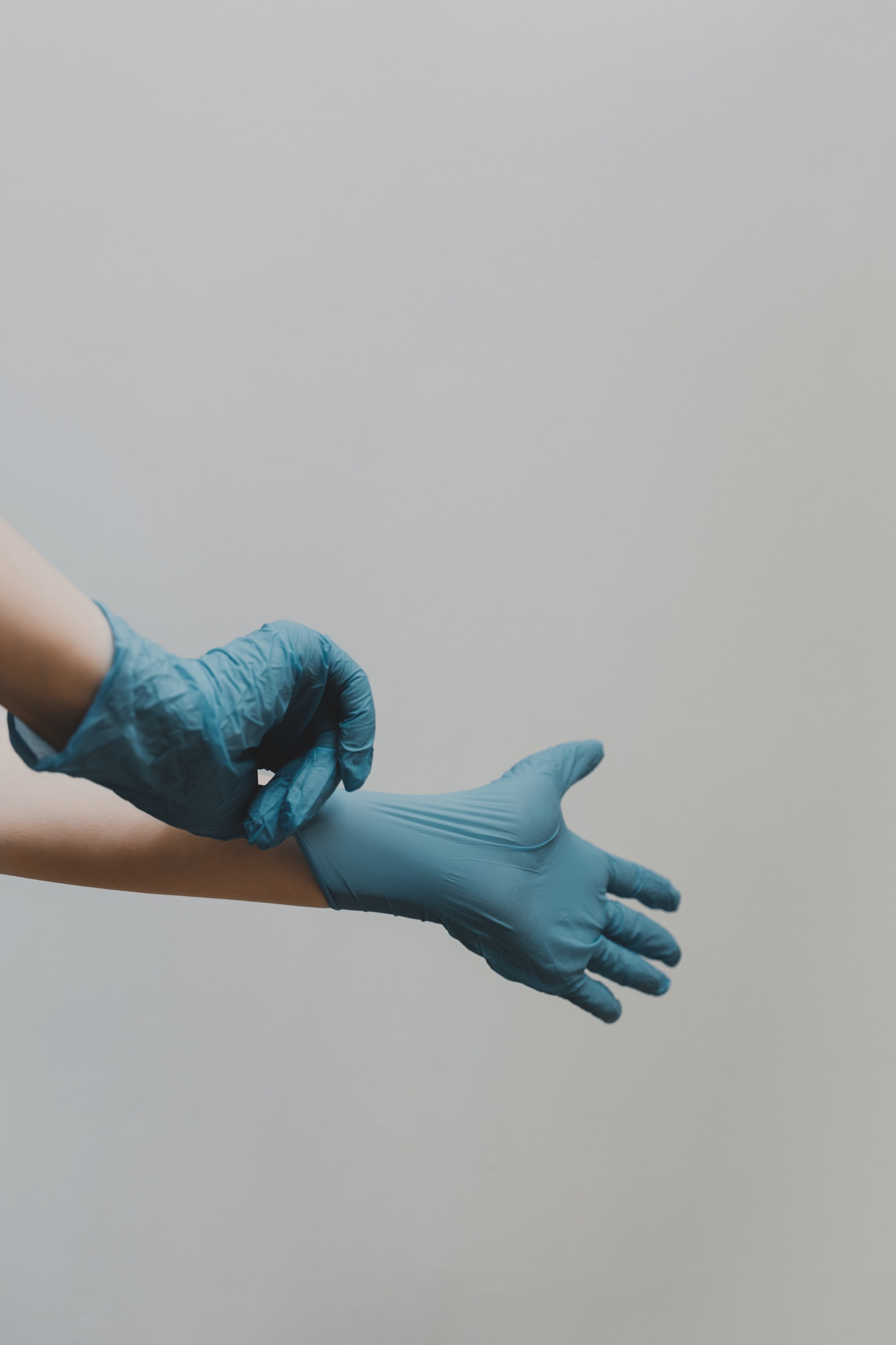 Doctor wearing latex gloves