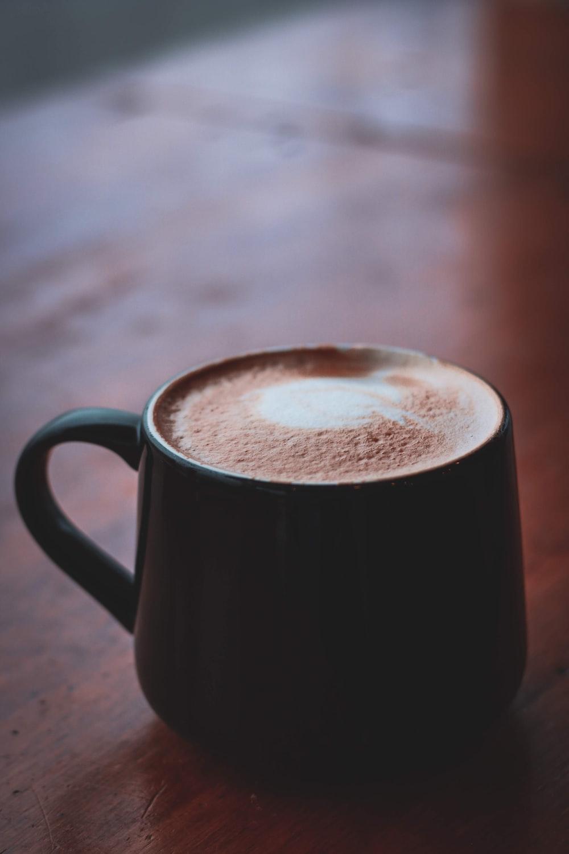 brown ceramic mug with brown liquid
